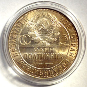 Золотистая патина на медной монете